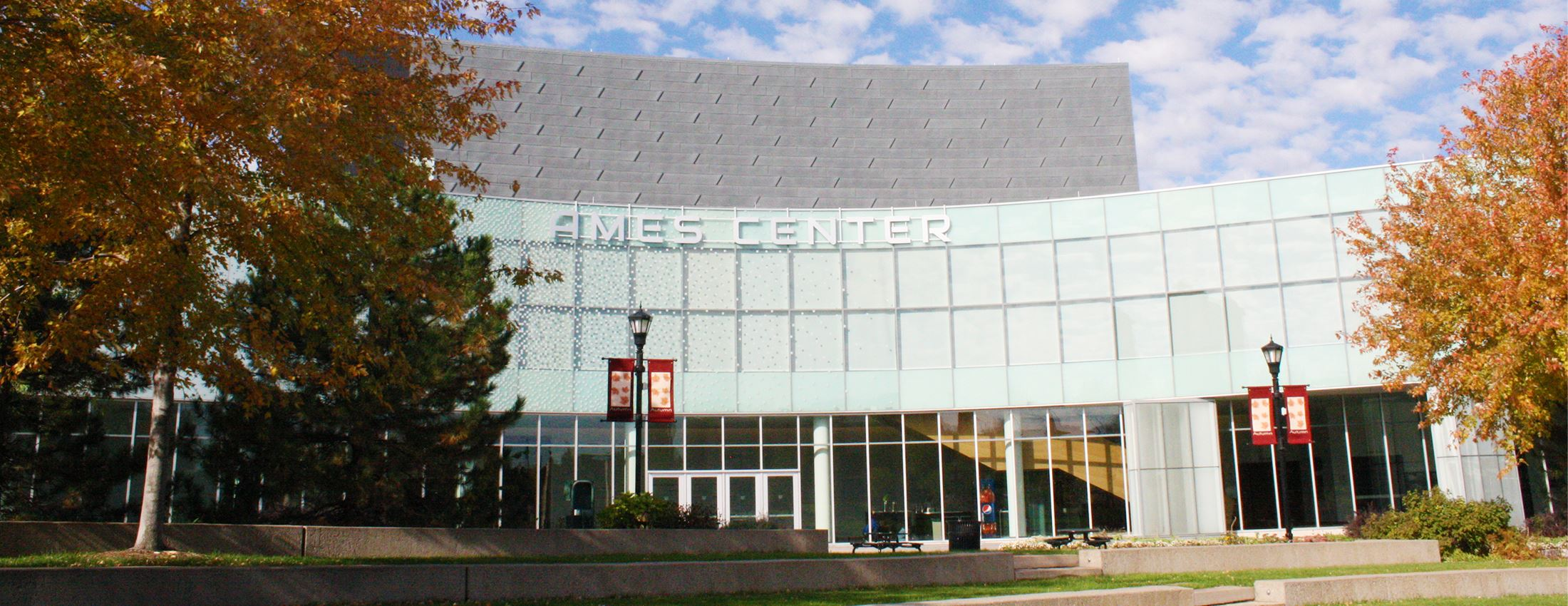 Ames Center surrounded by trees with fall-color leaves